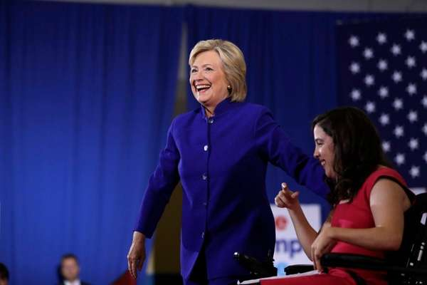 Democratic presidential candidate Hillary Clinton moves to the