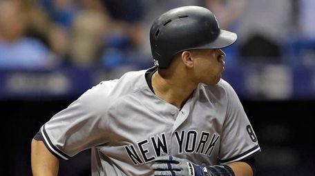 New York Yankees' Gary Sanchez drops his bat