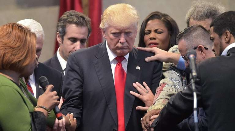 Pastors and attendees pray over Donald Trump at
