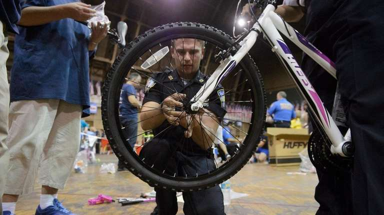 Port Authority Police Officer Liam Huczko assembles a
