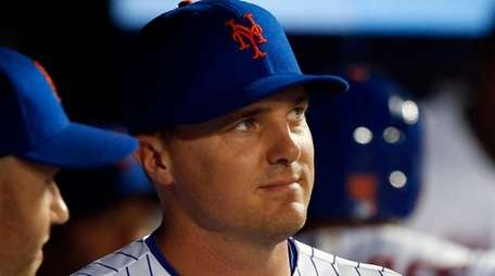 Jay Bruce of the Mets looks on from
