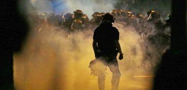 Police fire tear gas as demonstrators converge in