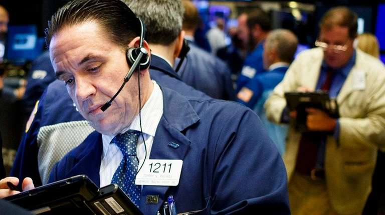 Traders work on the floor at the opening
