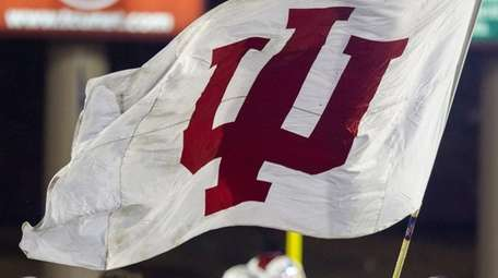 The Indiana cheer squad waves a school flag