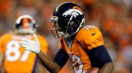Denver Broncos wide receiver Emmanuel Sanders (10) celebrates