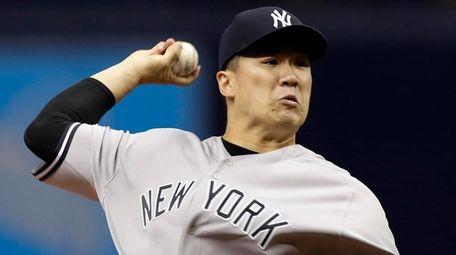 New York Yankees' Masahiro Tanaka pitches to the