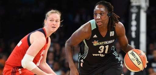 New York Liberty's Tina Charles controls the ball