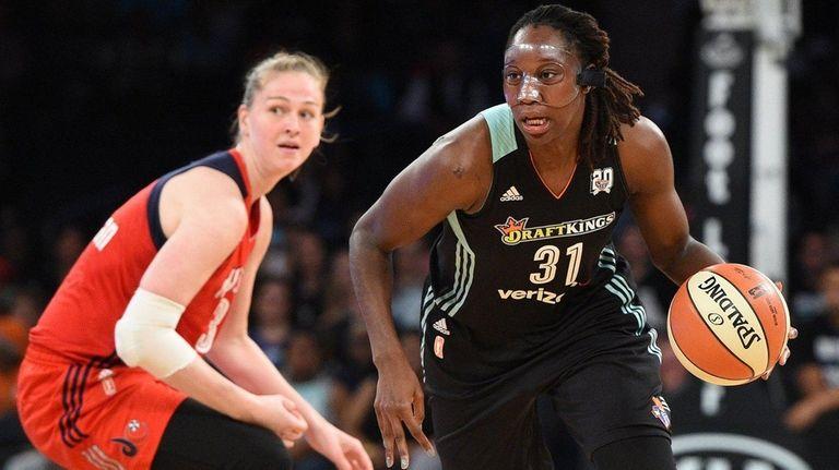 New York Liberty's Tina Charles controls the ball