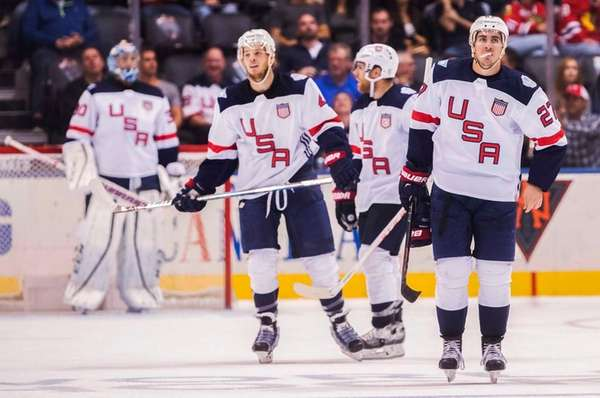 Team USA's Ryan McDonagh, right, reacts after his