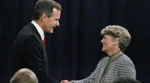 Then-Vice President George H. W. Bush shakes hands