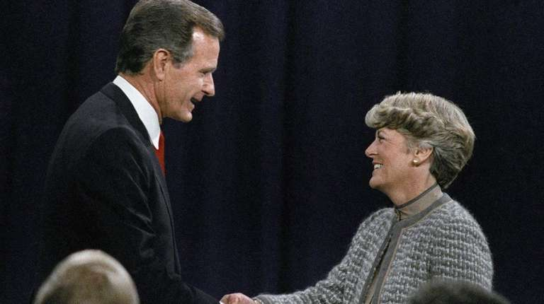 Then-Vice President George H.W. Bush shakes hands with