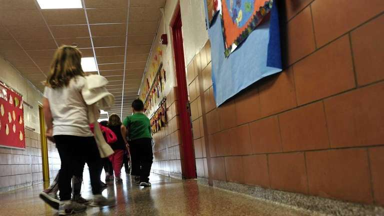 A first-grade class returns to the classroom.