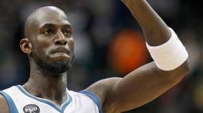 Minnesota Timberwolves forward Kevin Garnett (21) waves during