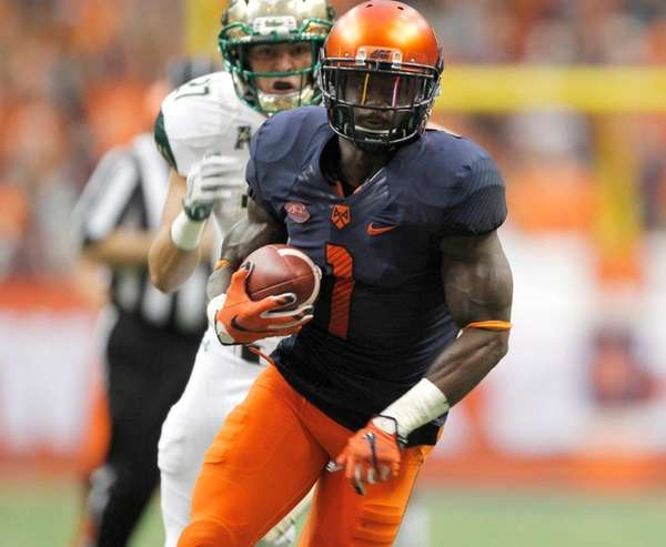 Syracuse's Brisly Estime, right, runs for a touchdown