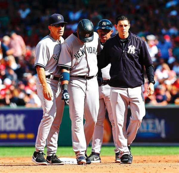 The New York Yankees' Starlin Castro leaves during