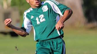Josiah Pena of Carle Place moves the ball
