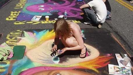 Participants in the 2008 festival create a painting