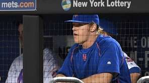 Mets pitcher Noah Syndergaard looks on from the