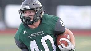 Westhampton Beach's Dylan Laube runs for a big