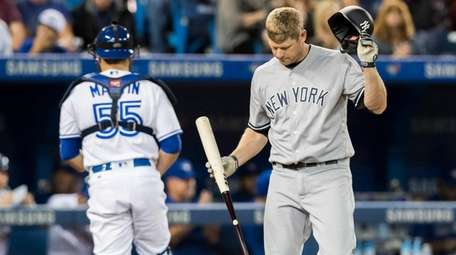 Yankees' Chase Headley reacts after striking out with