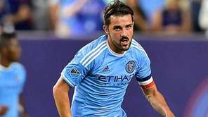 New York City FC forward David Villa chases