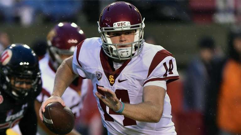 Sam Darnold of the USC Trojans runs with