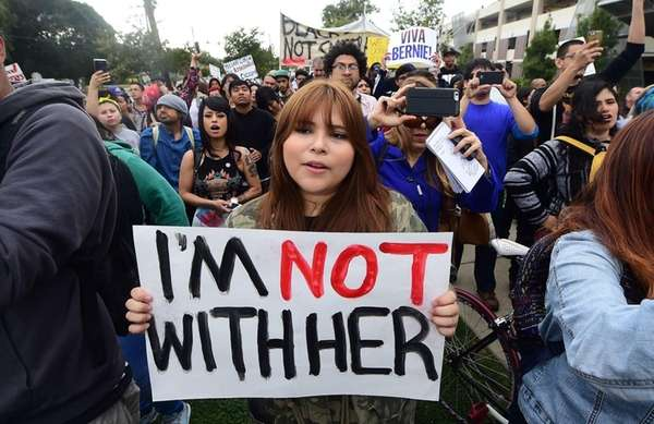 Protesters from Latino and Community groups make their