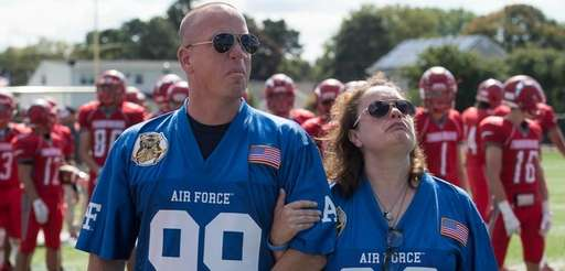 David and Regina Stagliano watch a flyover during
