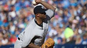 CC Sabathia delivers a pitch in the first