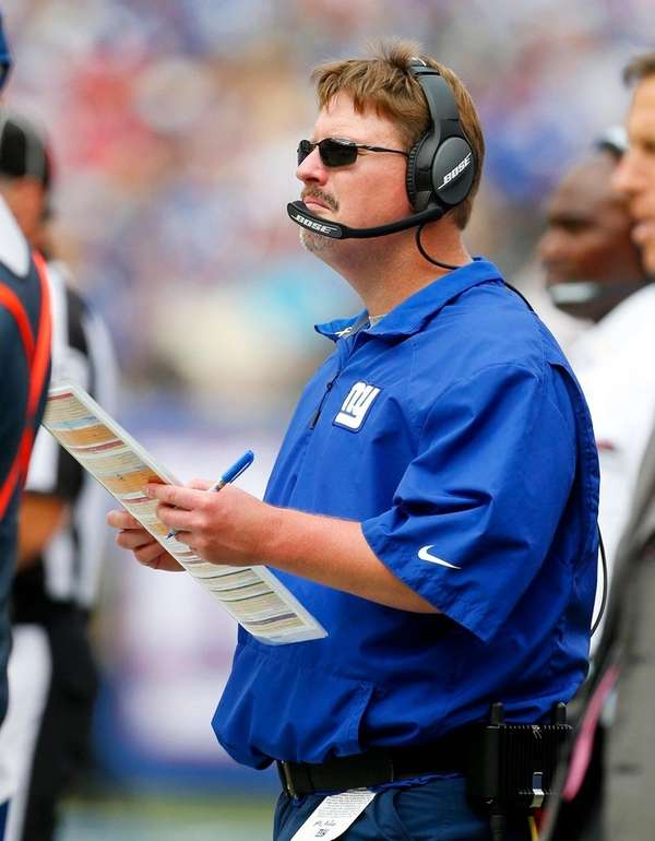 Giants coach Ben McAdoo watches his team against