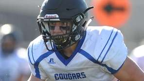 Alec Kiernan of Centereach rushes for a gain