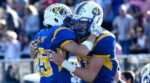 West Islip's Pat Mulcahy, left, and Joe Valentino,