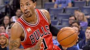 Derrick Rose plays in the first half of