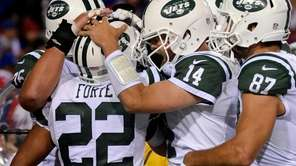 Jets running back Matt Forte celebrates his touchdown