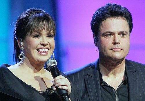 Performing siblings Marie Osmond and Donny Osmond in