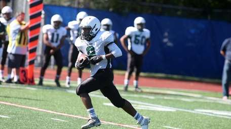 Elmont wide receiver Sevin Malcolm scores a
