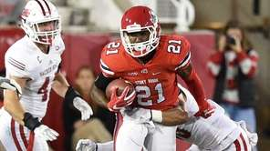 Stony Brook running back Stacey Bedell is tackled