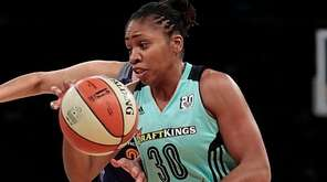 New York Liberty guard Tanisha Wright drives the