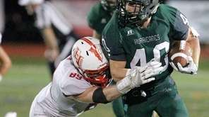 Westhampton's Dylan Laube (40) gets taken down by
