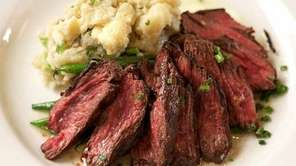 Grilled hanger steak is served with Camembert mashed
