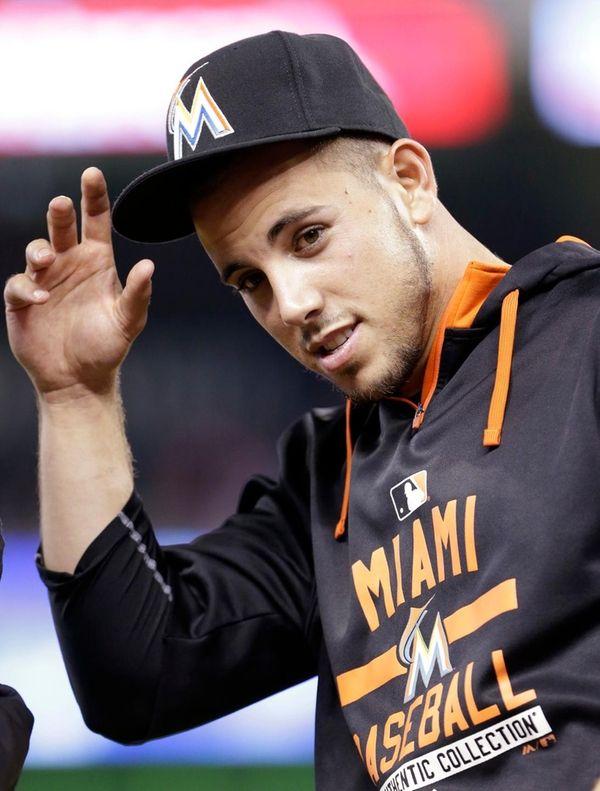 Miami Marlins pitcher Jose Fernandez replaces his cap