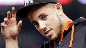 Miami Marlins pitcher Jose Fernandez replaces his cap