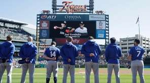 Members of the Kansas City Royals stand during