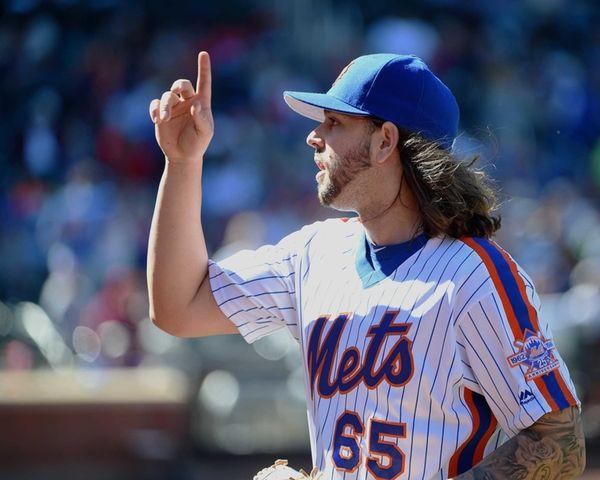 New York Mets starting pitcher Robert Gsellman reacts