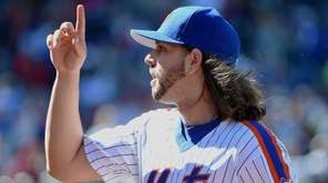 New York Mets starting pitcher Robert Gsellman reacts