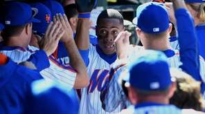 New York Mets centerfielder Curtis Granderson is greeted