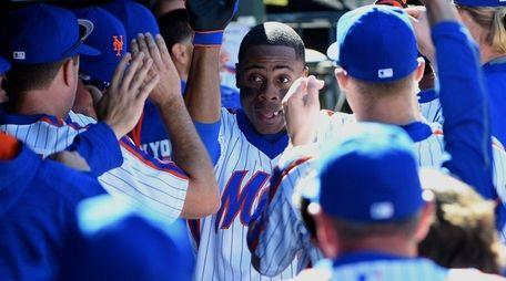 New York Mets centerfielder Curtis Granderson is greeted