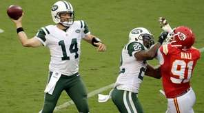 New York Jets quarterback Ryan Fitzpatrick throws as