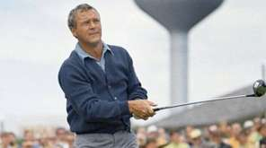 Photo shows Arnold Palmer in action at the