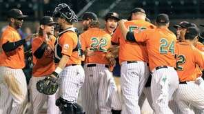The Long Island Ducks celebrate after their 5-1